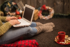 the girl with the computer and with the beautiful Christmas decor and concept holidays